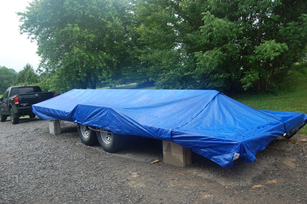 I made a makeshift ridge to help the water run off the tarp.